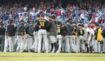 Pittsburgh Pirates starting pitcher Joe Musgrove (59) is held back by his teammates during a brief scuffle with the Atlanta Braves in the first inning of a baseball game Monday, June 10, 2019, in Atlanta. Musgrove was ejected from the game. (AP Photo/John Bazemore)