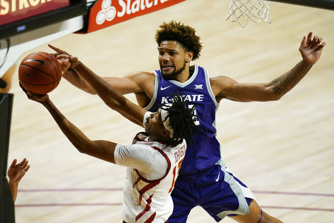 Kansas State forward David Bradford, rear, blocks a shot by Iowa State forward Javan Johnson during the second half of an NCAA college basketball game, Tuesday, Dec. 15, 2020, in Ames, Iowa. Kansas State won 74-65. (AP Photo/Charlie Neibergall)
