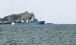 South Korea's government ship for a fishery guidance is seen near Yeonpyeong island, South Korea, Saturday, Sept. 26, 2020. South Korea said Saturday it will request North Korea to further investigate the killing of a South Korean government official who was shot by North Korean troops after being found adrift near the rivals' disputed sea boundary while apparently trying to defect. (Choi Jin-suk/Newsis via AP)