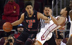 Utah guard Sedrick Barefield, left, knocks over Southern California guard Derryck Thornton on a drive during the first half of an NCAA college basketball game Wednesday, Feb. 6, 2019, in Los Angeles. (AP Photo/Mark J. Terrill)