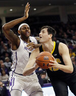 Iowa forward Ryan Kriener, right, looks to the basket as Northwestern center Dererk Pardon guards during the first half of an NCAA college basketball game Wednesday, Jan. 9, 2019, in Evanston, Ill. (AP Photo/Nam Y. Huh)