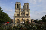 Notre Dame cathedral is pictured Thursday, April 18, 2019 in Paris. France paid a daylong tribute Thursday to the Paris firefighters who saved Notre Dame Cathedral from collapse, while construction workers rushed to secure an area above one of the church's famed rose-shaped windows and other vulnerable sections of the fire-damaged landmark. (AP Photo/Michel Euler, Pool)