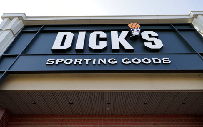 FILE- This Feb. 28, 2018, file photo shows a Dick's Sporting Goods store in Arlington Heights, Ill. Dick's Sporting Goods Inc. said on Tuesday, March 12, 2019, that it will stop selling hunting rifles and ammunition at 125 of its stores, replacing the gear with merchandise it believes will sell better at those locations. (AP Photo/Nam Y. Huh, File)