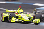 Simon Pagenaud, of France, drives through a turn on his way to winning the Indy GP IndyCar auto race at Indianapolis Motor Speedway, Saturday, May 11, 2019, in Indianapolis. (AP Photo/Michael Conroy)