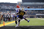 Florida tight end Kyle Pitts is unable to catch a pass in the end zone as Missouri defensive back Khalil Oliver (20) defends during the first half of an NCAA college football game Saturday, Nov. 16, 2019, in Columbia, Mo. (AP Photo/Jeff Roberson)