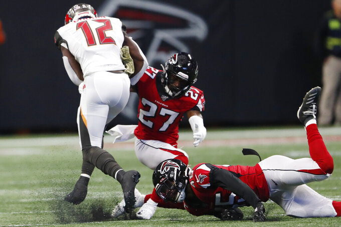 Atlanta Falcons linebacker Deion Jones (45) and Atlanta Falcons strong safety Damontae Kazee (27) misse the tackle on Tampa Bay Buccaneers wide receiver Chris Godwin (12) during the first half of an NFL football game, Sunday, Nov. 24, 2019, in Atlanta. Godwin scored a touchdown. (AP Photo/John Bazemore)