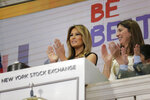 New York Stock Exchange President Stacey Cunningham, right, and first lady Melania Trump, with the help of students from the United Nations International School, ring the opening bell of the NYSE in New York, Monday, Sept. 23, 2019. (AP Photo/Seth Wenig)