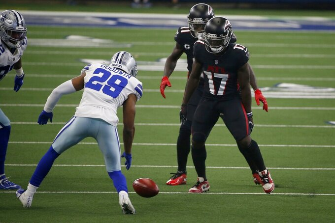 Dallas Cowboys cornerback C.J. Goodwin (29) follows on Cowboys onside kick as Atlanta Falcons' Olamide Zaccheaus (17) looks on in the second half of an NFL football game in Arlington, Texas, Sunday, Sept. 20, 2020. Goodwin recovered the kick. (AP Photo/Ron Jenkins)