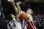 Oklahoma forward Brady Manek (35) and Kansas State guard David Sloan (4) collide during the first half of an NCAA college basketball game in Manhattan, Kan., Wednesday, Jan. 29, 2020. (AP Photo/Orlin Wagner)