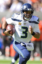 Seattle Seahawks quarterback Russell Wilson rushes for a 16-yard touchdown during the first half of an NFL football game against the Cleveland Browns, Sunday, Oct. 13, 2019, in Cleveland. (AP Photo/David Richard)