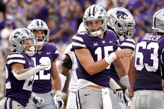 Kansas State quarterback Will Howard (15) celebrates with teammates after scoring a touchdown during the first half of an NCAA college football game against Southern Illinois, Saturday, Sept. 11, 2021, in Manhattan, Kan. (AP Photo/Charlie Riedel)