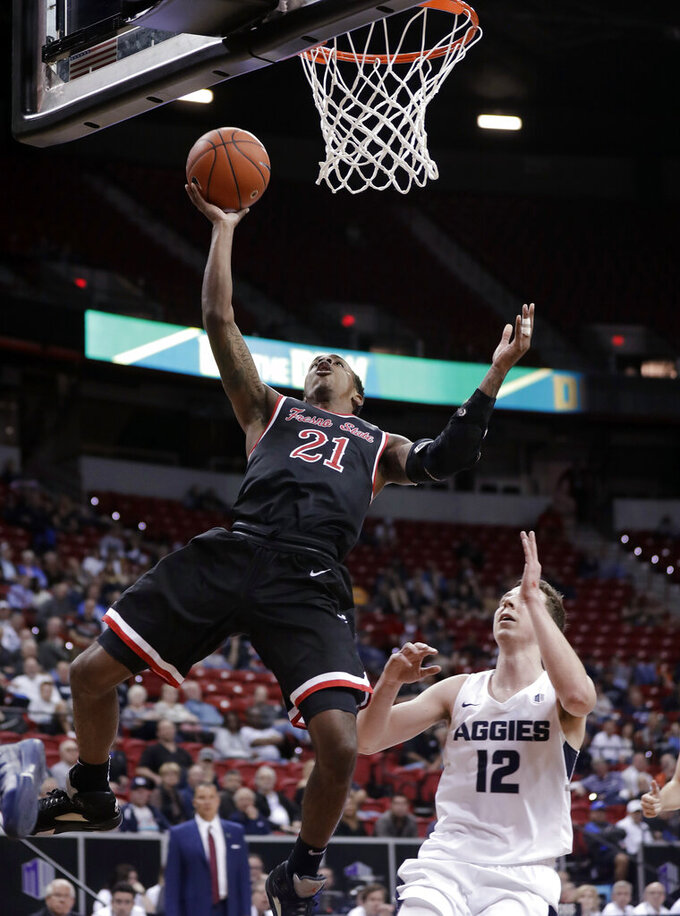 Fresno State's Deshon Taylor shoots over Utah State's Justin Bean during the second half of an NCAA college basketball game in the Mountain West Conference men's tournament Friday, March 15, 2019, in Las Vegas. (AP Photo/Isaac Brekken)
