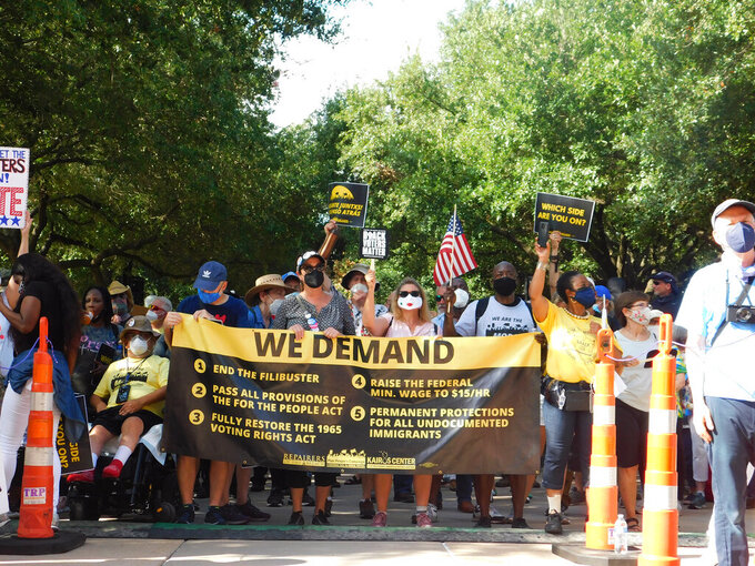 Protesters march for voting rights at the Texas Capitol in Austin, Texas on Saturday, July 31, 2021.  Hundreds of people packed the steps of the Texas Capitol as a protest rally which began Wednesday and ended Saturday with participants marching up to the doors of the Texas Capitol building.  (AP Photo/Acacia Coronado)