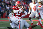 Rutgers wide receiver Isaiah Washington fumbles the ball as he is tackled by Ohio State cornerback Jeff Okudah (1) during the first half of an NCAA college football game Saturday, Nov. 16, 2019, in Piscataway, N.J. (AP Photo/Adam Hunger)