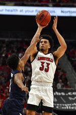 Louisville forward Jordan Nwora (33) shoots over the defense of Akron guard Tyler Cheese (4) during the second half of an NCAA college basketball game in Louisville, Ky., Sunday, Nov. 24, 2019. (AP Photo/Timothy D. Easley)