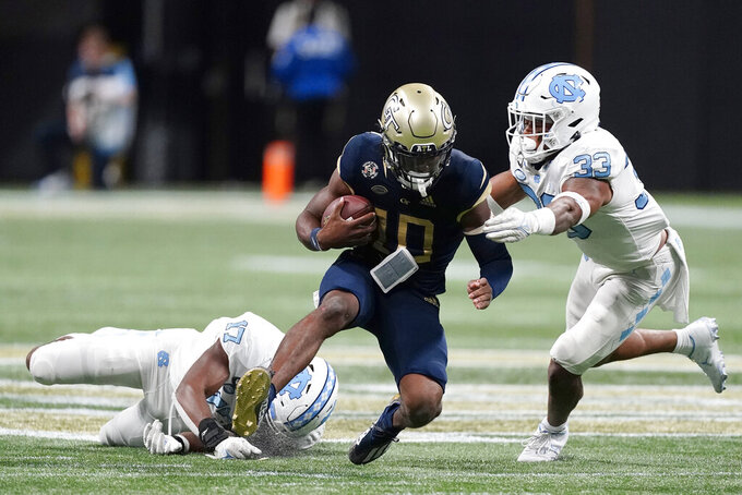 Georgia Tech quarterback Jeff Sims (10) is stopped by North Carolina linebackers Cedric Gray (33) and Chris Collins (17) after a short run in the second half of an NCAA college football game Saturday, Sept. 25, 2021, in Atlanta. (AP Photo/John Bazemore)