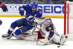 Columbus Blue Jackets goaltender Joonas Korpisalo (70), of Finland, makes a save against Tampa Bay Lightning's Alex Killorn during the second period of an NHL hockey game Sunday, April 25, 2021, in Tampa, Fla. (AP Photo/Mike Carlson)