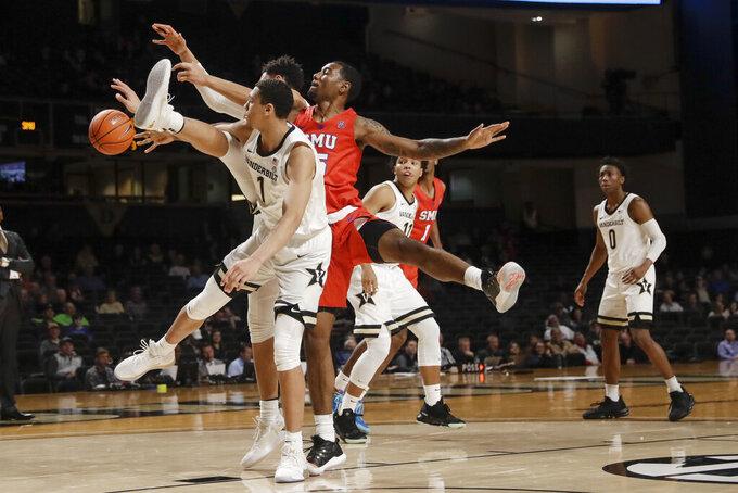 Vanderbilt forward Dylan Disu (1) and SMU forward Isiaha Mike (15) battle for a rebound during the first half of an NCAA college basketball game Saturday, Jan. 4, 2020, in Nashville, Tenn. (AP Photo/Mark Humphrey)