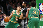 Boston Celtics center Enes Kanter (11) drives against Brooklyn Nets forward Wilson Chandler (21) during the first half of an NBA basketball game Tuesday, March 3, 2020, in Boston. (AP Photo/Mary Schwalm)