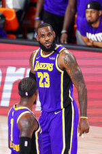 Los Angeles Lakers' LeBron James (23) has words with teammate Kentavious Caldwell-Pope (1) during the second half of an NBA conference final playoff basketball game against the Denver Nuggets Saturday, Sept. 26, 2020, in Lake Buena Vista, Fla. (AP Photo/Mark J. Terrill)