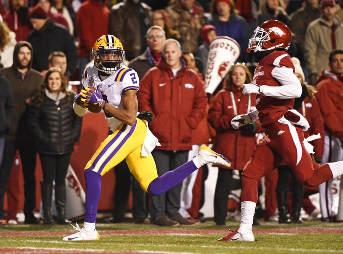 LSU receiver Justin Jefferson (2) makes a touchdown catch in front of Arkansas defender Kamren Curl during the first half of an NCAA college football game, Saturday, Nov. 10, 2018, in Fayetteville, Ark. LSU won, 24-17. (AP Photo/Michael Woods)