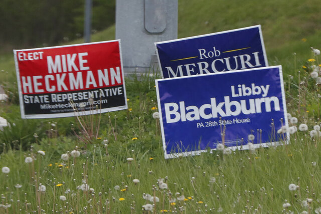This photo from May 1, 2020, shows local government candidate's campaign signs along a roadside in Wexford, Pa. The state's primary election is June 2, 2020 and will feature legislative and congressional races, a first run for some new paper-record voting systems and the inaugural use of newly legalized mail-in ballots. Pennsylvanians have embraced the state's new vote-by-mail option that was passed last year but has been widely adopted as a way to avoid pandemic exposure. (AP Photo/Keith Srakocic)