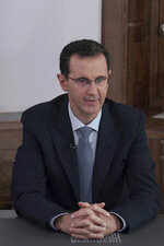 In this photo released on the official Facebook page of the Syrian Presidency, Syrian President Bashar Assad speaks during a televised address in Damascus , Syria, Monday, Feb. 17, 2020. Assad congratulated his forces Monday for consolidating control over the entire province of Aleppo in northern Syria, pledging to press ahead with a military campaign to achieve complete victory