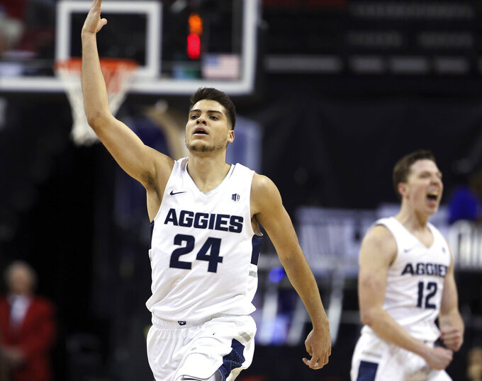 Utah State's Diogo Brito (24) reacts after scoring during the second half of the team's NCAA college basketball game against New Mexico in the Mountain West Conference men's tournament Thursday, March 14, 2019, in Las Vegas. (AP Photo/Isaac Brekken)