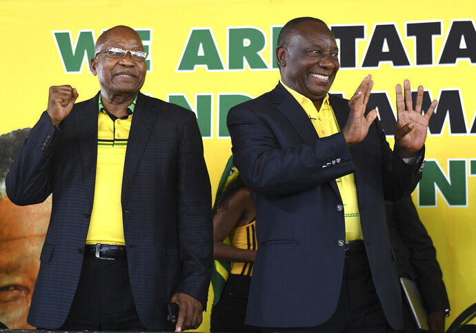 In this photo taken Tuesday Jan. 8, 2019, former South African president Jacob Zuma, left, and President Cyril Ramaphosa attend the African National Congress' 107th birthday celebrations in Durban, South Africa. Zuma, who was forced from office last year by scandal, is now in the midst of a remarkable makeover, wooed by a ruling party that recognises his enduring appeal to some supporters and is anxious to paper over divisions ahead of elections this year. (AP Photo)
