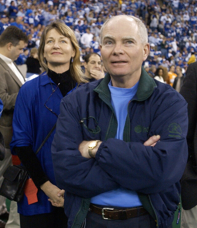FILE - In this Jan. 9, 2005 file photo, Indiana Gov. Joe Kernan, right, and Lt. Gov. Kathy Davis wait for the start of the AFC wild-card game against the Denver Broncos in Indianapolis. Kernan has died at age 74. His governor's office chief of staff says Kernan died early Wednesday, July 29, 2020 at a South Bend health care facility. (AP Photo/Darron Cummings, File)