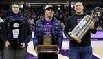 CORRECTS ID TO TOMMY DOLES NOT TREY KLOCK Northwestern football players Paddy Fisher, left, hold the Big 10 West Division Champion trophy, Isaiah Bowser, center, holds the Land of Lincoln Trophy and Tommy Doles hold the Holiday Bowl Champion trophy during the first half of an NCAA college basketball game against Iowa, Wednesday, Jan. 9, 2019, in Evanston, Ill. (AP Photo/Nam Y. Huh) Tommy Doles