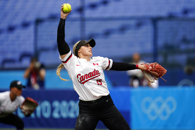 Canada's Danielle Lawrie pitches during a softball game against Italy at Yokohama Baseball Stadium during the 2020 Summer Olympics, Monday, July 26, 2021, in Yokohama, Japan. (AP Photo/Matt Slocum)