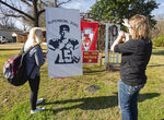 Victoria Buckley, 16, helps her mom Natalie Buckley, at right, think through the placement of their Patrick Mahomes and Kansas City Chiefs decorations outside of Consider the Lilies, a floral shop in Whitehouse, Texas, on Monday, Jan. 27, 2020. The Chiefs are playing the San Francisco 49ers in the upcoming Super Bowl. Whitehouse is Patrick Mahomes' hometown. (Sarah A. Miller/Tyler Morning Telegraph via AP)