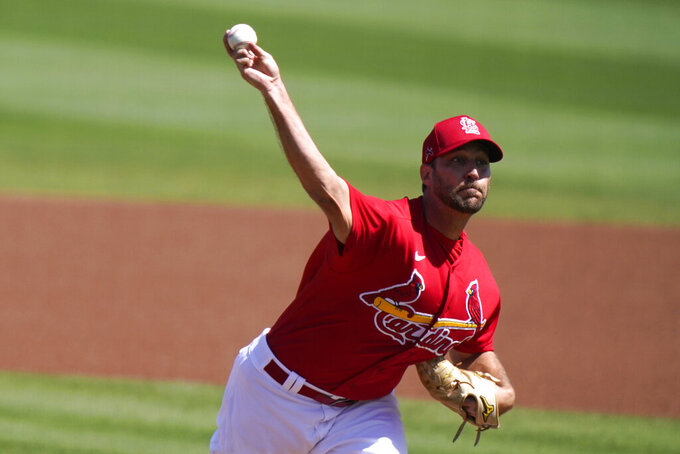 St. Louis Cardinals starting pitcher Adam Wainwright throws during the first inning of a spring training baseball game against the Houston Astros, Sunday, March 7, 2021, in Jupiter, Fla. (AP Photo/Lynne Sladky)