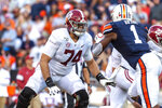 FILE - In this Nov. 30, 2019, file photo, Alabama offensive lineman Jedrick Wills Jr. (74) sets up to block against Auburn defensive lineman Big Kat Bryant (1) during the first half of an NCAA college football game in Auburn, Ala. Wills allowed one sack in 39 college games, playing exclusively at right tackle. (AP Photo/Vasha Hunt, File)