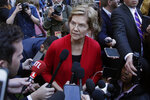 Democratic presidential candidate Sen. Elizabeth Warren, D-Mass., listens to a reporter's question at a campaign event, Thursday, Oct. 24, 2019, in Hanover, N.H. (AP Photo/Elise Amendola)