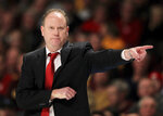 FILE - In this Feb. 6, 2019, file photo, Wisconsin coach Greg Gard gestures during the second half of the team's NCAA college basketball game against Minnesota in Minneapolis. Wisconsin begins this pandemic-delayed season with most of the same players who created so many memorable moments during a magical stretch drive last year. (AP Photo/Andy Clayton-King, File)