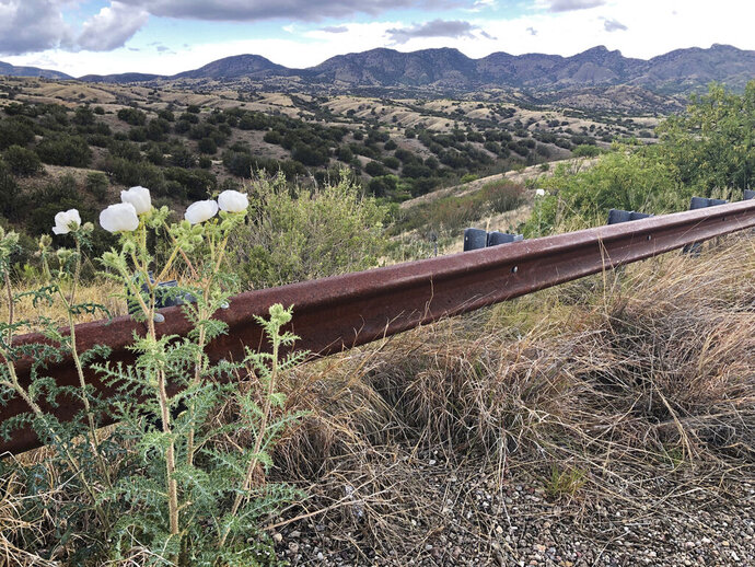 FILE - This file photo taken Monday, May 12, 2019, off Arizona scenic state Highway 83 shows the eastern slope of the Santa Rita Mountains where Canadian firm Hudbay Minerals Inc. plans an open pit copper mine. A federal judge has overturned the U.S. Forest Service's approval of a Canadian company's planned new copper mine in southeastern Arizona. The judge ruled, Wednesday, Aug. 1 2019,  the agency improperly evaluated and considered water use issues associated with the Rosemont Mine planned in the Santa Rita Mountains on part of the Coronado National Forest. (AP Photo/Anita Snow,File)