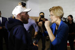 Sen. Elizabeth Warren, D-Mass., talks with a local resident during an organizing event, Sunday, Feb. 10, 2019, in Cedar Rapids, Iowa.(AP Photo/Charlie Neibergall)