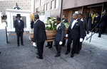 Pallbearers take the casket of opera star Jessye Norman to a horse-drawn hearse following funeral services at the William B. Bell Auditorium in Augusta, Ga., Saturday, Oct. 12, 2019. Norman died Sept. 30 at age 74. A trailblazing performer, she was one of the rare black singers to attain worldwide stardom in the opera world. (Michael Holahan/The Augusta Chronicle via AP)