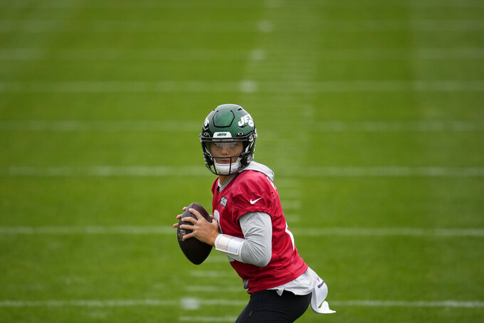 New York Jets' quarterback Zach Wilson takes part in an NFL practice session at Hanbury Manor Marriott Hotel and Country Club near the town of Ware, in south east England, Friday, Oct. 8, 2021. The New York Jets are preparing for an NFL regular season game against the Atlanta Falcons in London on Sunday. (AP Photo/Matt Dunham)