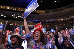 FILE - In this July 26, 2016, file photo, delegates cheer as Democratic Presidential candidate Hillary Clinton appears on the screen during the second day session of the Democratic National Convention in Philadelphia. Democratic presidential candidate former Vice Presiden JoBiden's presidential nominating convention will highlight the U.S. political spectrum from the left flank of New York Rep. Alexandria Ocasio-Cortez to the Republican old guard of former Ohio Gov. John Kasich. But that doesn't mean there's room for every prominent Democrat who would get a share of the spotlight at a routine convention taking place without the backdrop of a pandemic. (AP Photo/Matt Rourke, File)