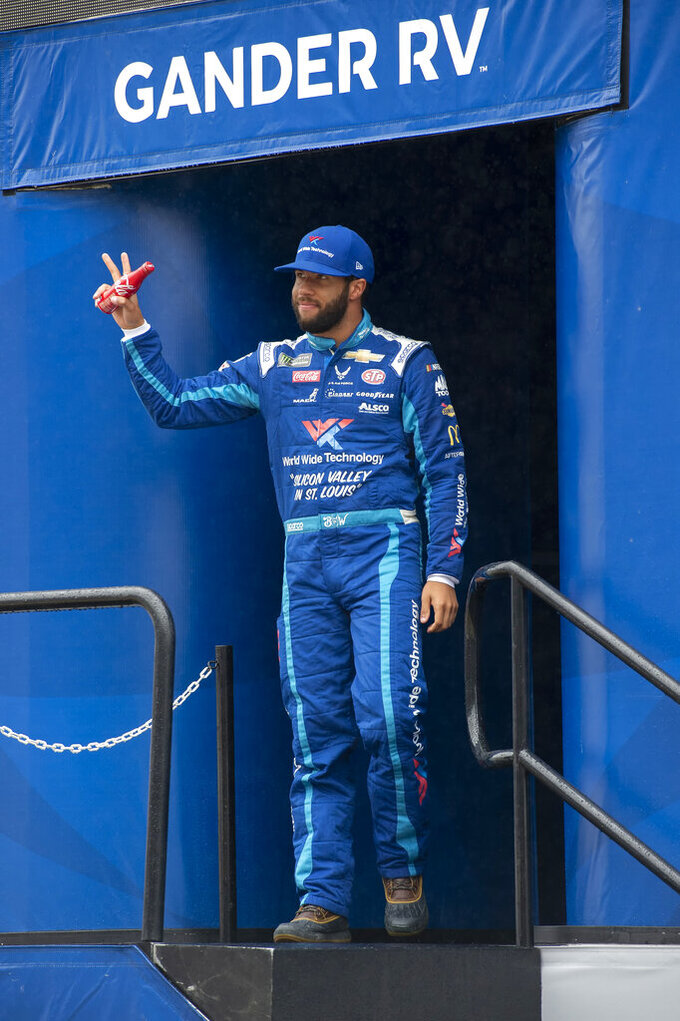 Bubba Wallace gestures during driver introductions at a NASCAR Cup Series auto race Sunday, May 5, 2019, at Dover International Speedway in Dover, Del. (AP Photo/Jason Minto)