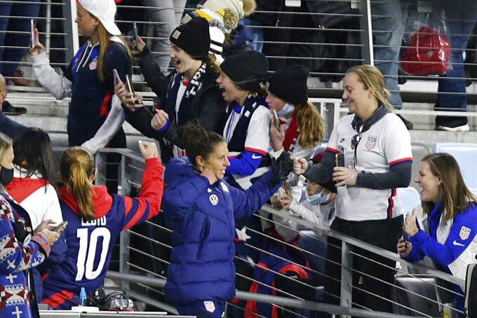 United States' forward Carli Lloyd takes the field for warms-up before a soccer friendly match against South Kore, Tuesday, Oct. 26, 2021, in St. Paul, Minn. (AP Photo/Andy Clayton-King)