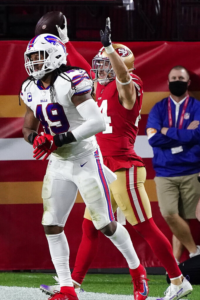 San Francisco 49ers fullback Kyle Juszczyk celebrates his touchdown as Buffalo Bills middle linebacker Tremaine Edmunds (49) walks away during the second half of an NFL football game, Monday, Dec. 7, 2020, in Glendale, Ariz. (AP Photo/Rick Scuteri)