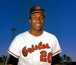FILE - In this 1967 file photo, Baltimore Orioles outfielder Frank Robinson smiles. Hall of Famer Frank Robinson, the first black manager in Major League Baseball and the only player to win the MVP award in both leagues, has died. He was 83. Robinson had been in hospice care at his home in Bel Air. MLB confirmed his death Thursday, Feb. 7, 2019.(AP Photo/File)