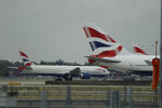 A British Airways plane, at left, is towed past other planes sitting parked at Heathrow Airport in London, Monday, Sept. 9, 2019. British Airways says it has had to cancel almost all flights as a result of a pilots' 48-hour strike over pay. (AP Photo/Matt Dunham)