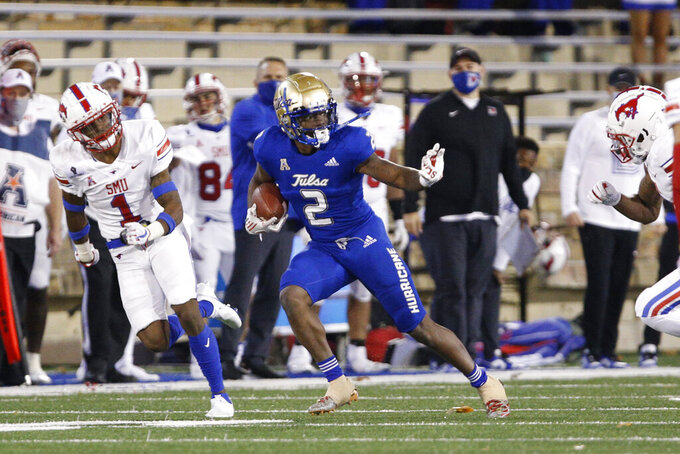 Tulsa wide receiver Keylon Stokes (2) gains after a catch against SMU during the second half of an NCAA college football game in Tulsa, Okla., Saturday, Nov. 14, 2020. (AP Photo/Joey Johnson)