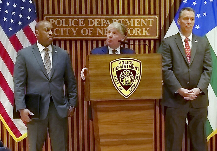 Manhattan District Attorney Cyrus Vance, Jr., briefs the media on the arrest of a 14-year-old male in the Dec.2019 murder of Barnard College student Tessa Majors, Saturday, Feb. 15, 2020 in New York. Majors, 18, was stabbed as she walked through New York City's Morningside Park early in the evening of Dec. 11. At left is NYPD Chief of Detectives Rodney Harrison and at right in New York City Police Commissioner Dermot Shea. (AP Photo/Julie Walker)