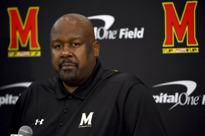 Maryland head coach Mike Locksley addresses the media during a news conference before NCAA college football practice, Friday, Aug. 2, 2019, in College Park, Md. (AP Photo/Will Newton)